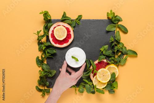 hand with citrus cream