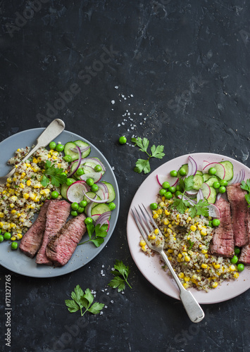 Foto op Plexiglas Steakhouse Grilled beef steak and quinoa corn mexican salad on dark background, top view. Delicious healthy balanced food concept
