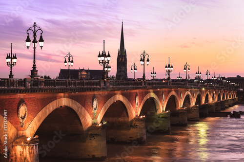 Pont de Pierre bridge at twulight, Bordeaux, France