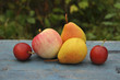Ripe fruit on table close up. Background, apples, pears, plums, texture