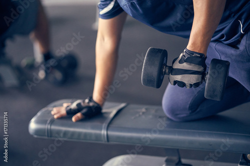 Asian man exercising in the gym, fitness, health, body good.
