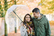 Lovely young couple in love at the park in autumn. Romantic man and woman portrait.
