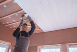 Construction worker thermally insulating eco wooden frame house - 171342122