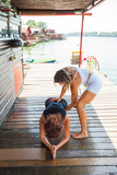 woman fitness instructor assisting young woman in exercise outdoor shot - 171366147