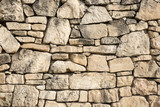 ancient wall made of stones  - 171369164