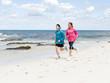 Young Couple Running along sea shore