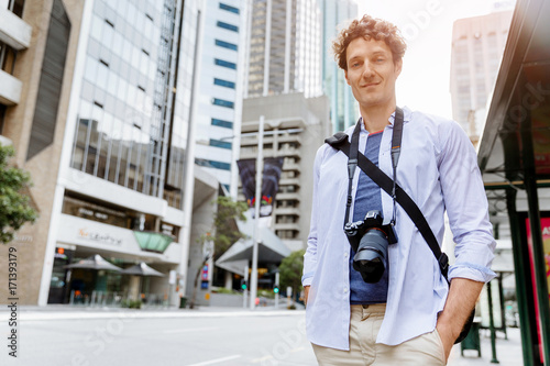 Poster Male tourist in city