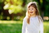 Beutiful happy child smiling outdoors - 171406568