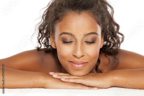 Aluminium Spa portrait of a beautiful young dark-skinned woman on a white background