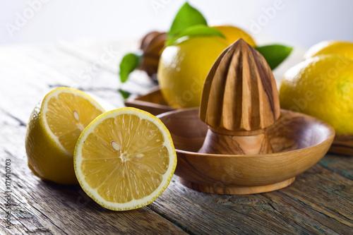 Fotobehang Sap Lemons and squeezer .