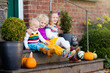 Kids at house porch on autumn day