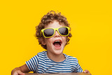 Adorable kid in bright sunglasses on orange - 171420943