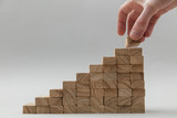 Male hand stacking wooden blocks. Business development and growth concept - 171423384