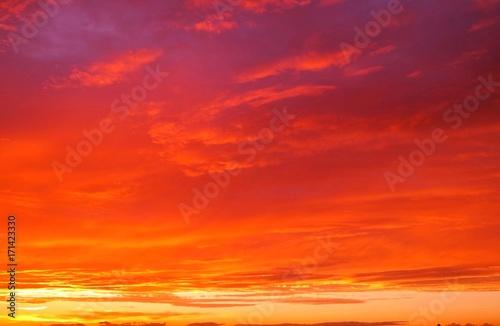 Foto op Canvas Rood 幻想的な夕焼けの背景イメージ