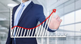 Businessman touching technology interface with financial curve and graph - 171428741
