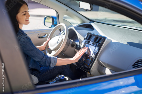 Beautiful smart woman sitting in her car