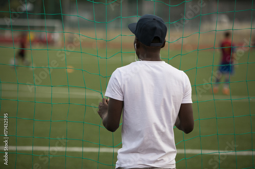 Fotobehang Voetbal Man looking how people plays football in stadium
