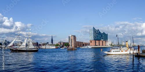 Leinwandbild Motiv Hamburg with panoramic view of the Elbphilharmonie and in the foreground sailing ship and steamer