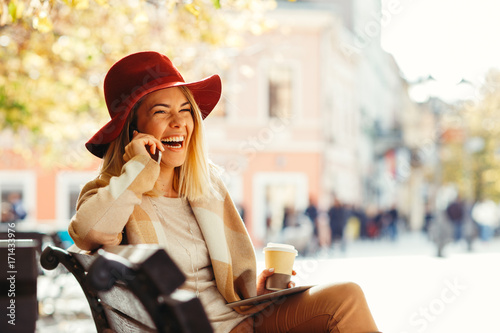 Beautiful young woman talking on mobile phone