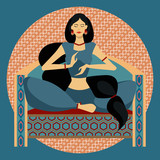 Oriental beauty sitting on the couch in lotus position on a complex colored and ornamental background
