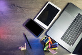 Laptop, smart phone, tablet pc and power bank on dark wooden background in the office. Top view - 171448999