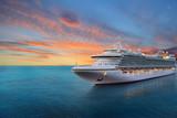 Luxury cruise ship sailing to port on sunrise  - 171454970