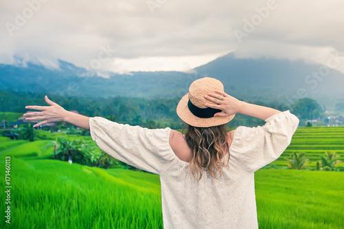 Happy woman traveling in jatiluwih rice terrace, Bali, Indonesia.