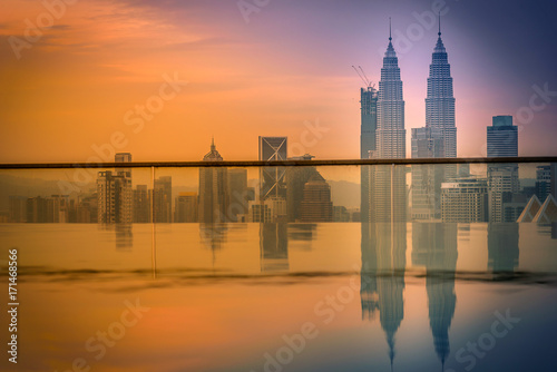 Fotobehang Kuala Lumpur Cityscape of Kuala lumpur city skyline with swimming pool on the roof top of hotel at sunrise in Malaysia.