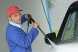 man washes foam machine carwash washing machine at the station - 171480120