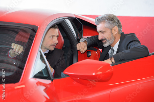 seller and rich customer discussing the ferrari performances Poster