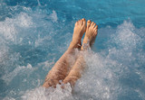 bare feet of young woman during a hydromassage session in the lu