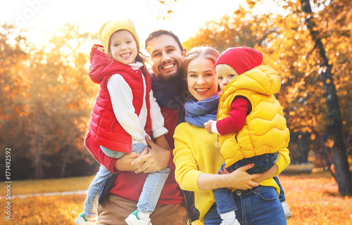 happy family mother, father and children on an autumn walk