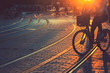 Blurred of people riding bicycle during the sunset in the city of Bordeaux in vintage style and grain texture with copy space - 171494792