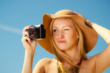 Beautiful elegant woman caught on taking pictures - 171497729