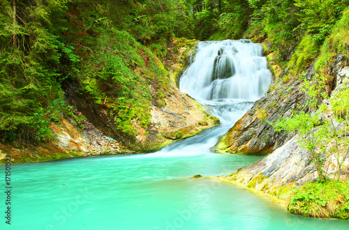 Foto op Canvas Groene koraal The Waterfall on mountain river. The Isar is a river in Tyrol, Austria and Bavaria, Germany. Its source is in the Karwendel range of the Alps in Tyrol; it enters Germany near Mittenwald.