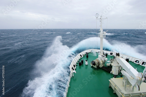 Fotobehang Antarctica Ship's Bow diving into a big splashing wave, antarctic ocean, Antarctica