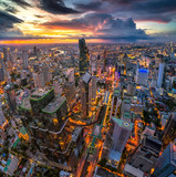 Aerial view of Bangkok buildings, Bangkok city downtown with sunset sky, Transaction beautiful road top view at night traffic