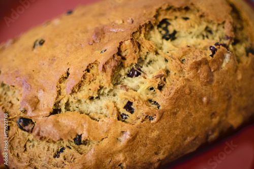 Fresh baked banana bread with fruit and nuts Poster