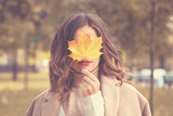Beautiful Autumn Woman with Autumn Leaves on Fall Nature Background - 171534155