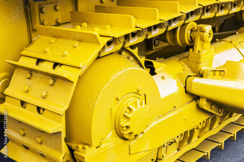 yellow tracks of the tractor or bulldozer. Construction equipment