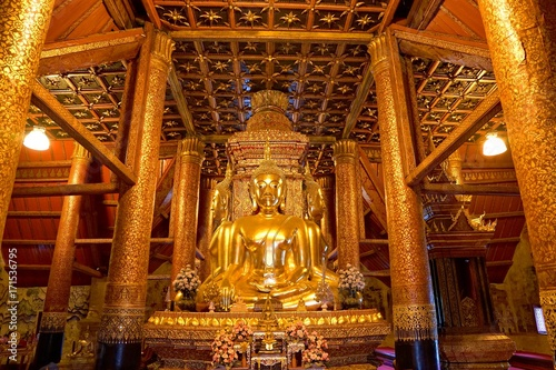 Fotobehang Thailand Golden four Buddha image in main hall of Wat Phumin or Phu min Temple at Nan province, NorthThailand