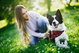 Beautiful woman walking cute dog in nature - 171539954