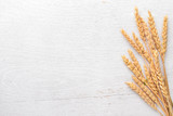 Wheat on a wooden background. Top view. Free space for text. - 171560501