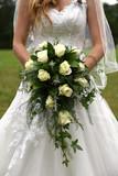 Bride holding cascading bridal bouquet - 171561569