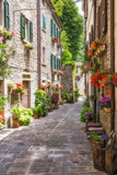 Narrow old street with flowers in Italy - 171568513