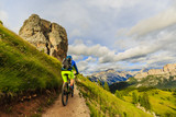 Tourist cycling in Cortina d'Ampezzo, stunning rocky mountains on the background. Man riding MTB enduro flow trail. South Tyrol province of Italy, Dolomites. - 171572113