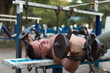 Muscular man doing exercises with dumbbells outdoors.