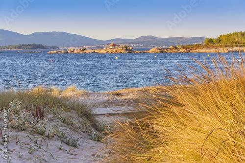 Fotobehang Vuurtoren Lighthouse from coastal dune