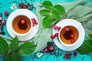 Natural tea with ripe raspberries, cherries, currants