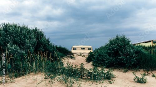 Staande foto Scandinavië Caravan Camping Trailer On The Sandy Beach. Transportation Rest Journey Outdoor Concept